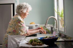Elderly washing vegetables